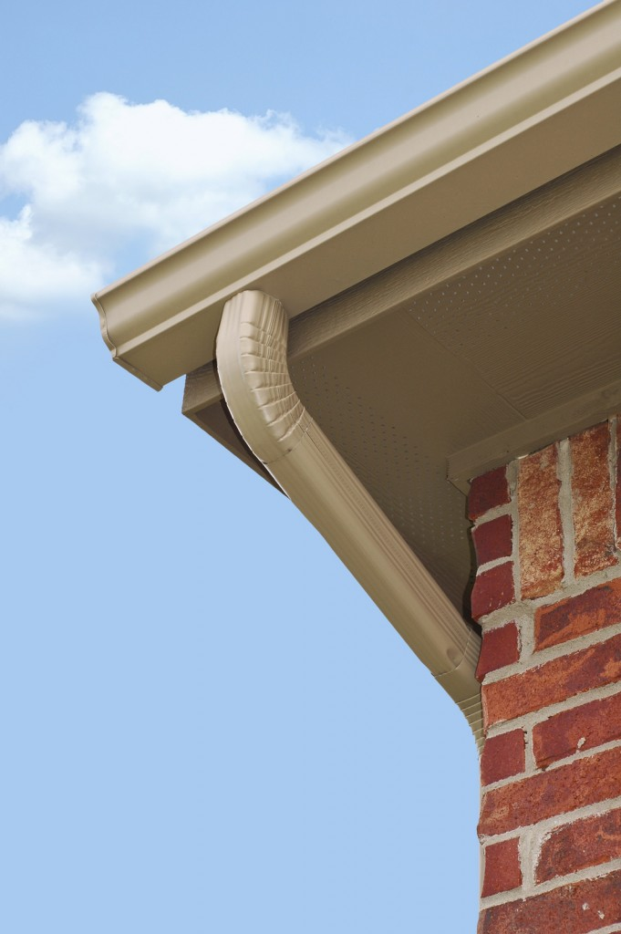 Edge of roof line with guttering and downspout